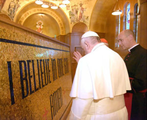Pope Francis blessing a piece of the Trinity Dome Mosaic