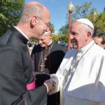 Monsignor Rossi welcomes Pope Francis.